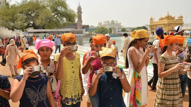 Devotees at Golden Temple on the occasion of martyrdom anniversary of Sikh Guru Arjun Dev in  Amritsar on Monday.