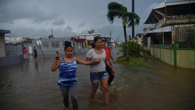 Inhabitants walk in flood water from the Puerto Nuevo river during the passage of Hurricane Maria, in San Juan. 'This might be a new, permanent part of our lives,' said Ramon Claudio Ortiz, 71, a retired lawyer. 'We're going to have to revisit our building codes.' Maria was the second-strongest hurricane ever recorded to make landfall in Puerto Rico, behind the 1928 San Felipe Segundo hurricane, which struck the island as a Category 5 storm and killed more than 300 people.