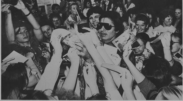 Amitabh Bachchan signing autographs for fans.