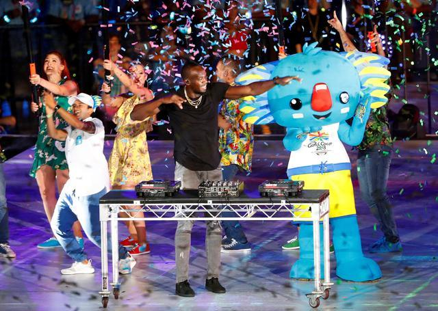 Former Jamaican sprinter Usain Bolts plays the DJ desks during the closing ceremony. (REUTERS)
