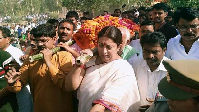 Amethi MP Smriti Irani plays pall-bearer for an aide. She stayed in the village till the last rites were performed, and before leaving for Delhi, she assured the villagers that she would do whatever it takes to track down the culprits responsible for party worker Surendra Singh's murder.