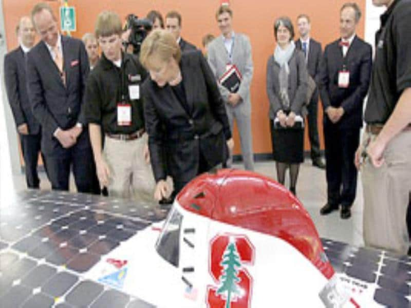 German Chancellor Angela Merkel looks at a solar car during the dedication of the new Volkswagen Group Automotive Innovation Laboratory at Stanford University.