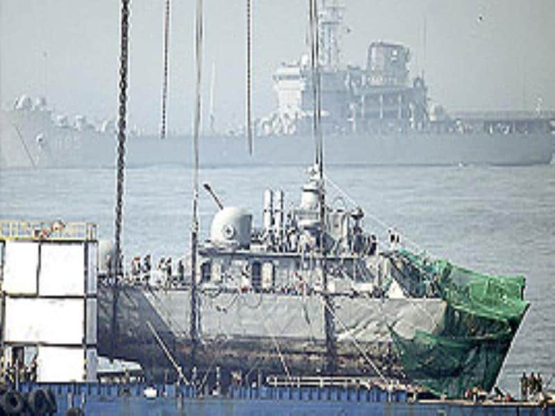 Officials investigate the stern section of the sunken South Korean naval ship Cheonan after it was salvaged off Baengnyeong Island, South Korea.