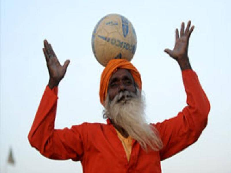 An Indian sadhu (Hindu holy man) poses with a football in Allahabad.