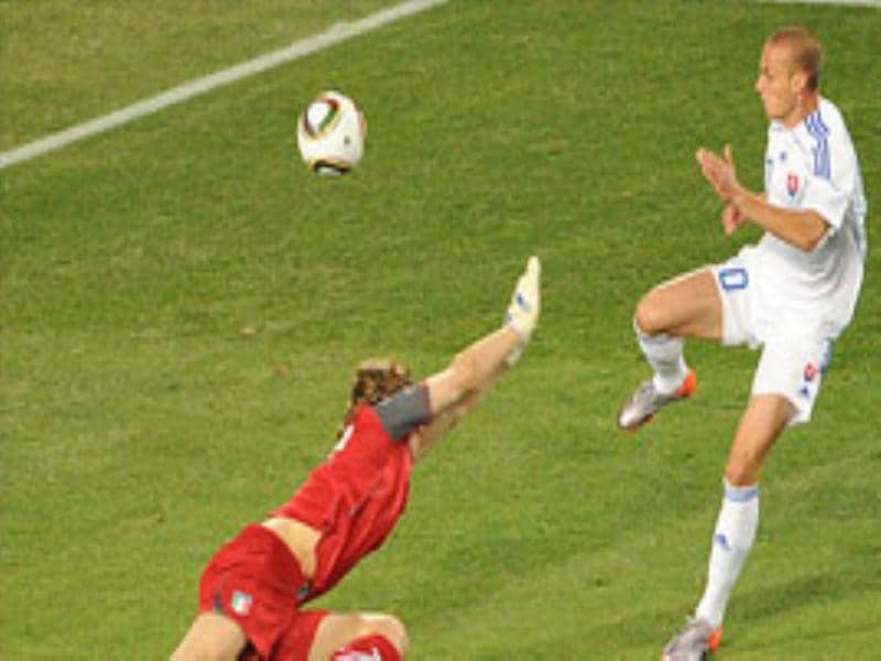 Slovakia's midfielder Kamil Kopunek (R) kicks the ball over Italy's goalkeeper Federico Marchetti to score a goal during their Group F first round 2010 World Cup football match.