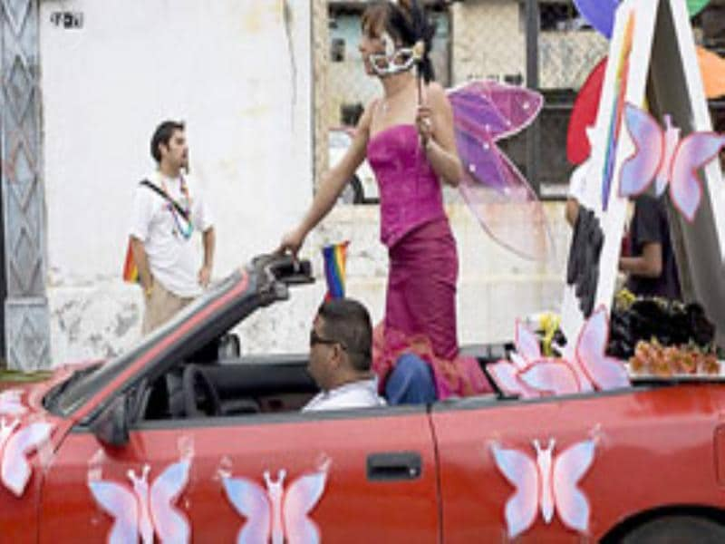 A transsexual performs on a car during the Gay Pride parade in Guatemala City.