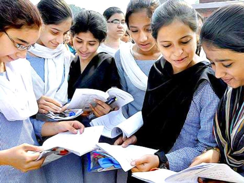 File photo of school students discussing their exam question paper. (PTI photo)