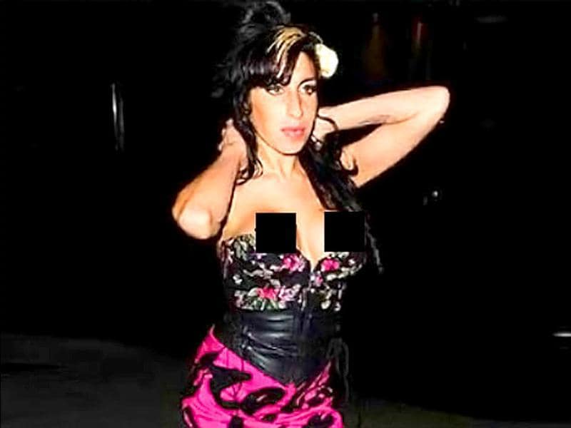Amy Winehouse should've really known that that dress was way too small for her.