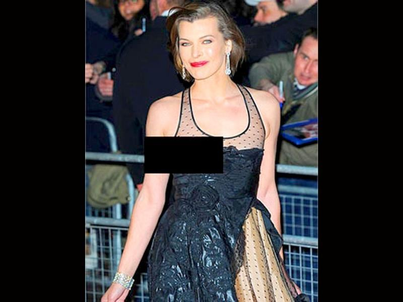 The latest victim of nip-slip, Milla Jovovich flashed her breast when her black tulle dress slipped just an inch.