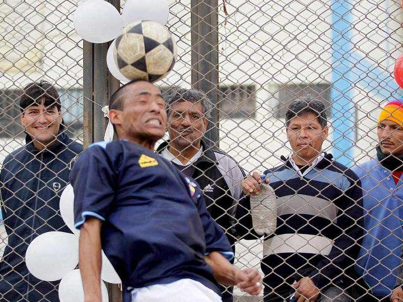 Peruvian prisoners watch the final match of their mock Copa America soccer tournament at Castro-Castro prison in Lima.