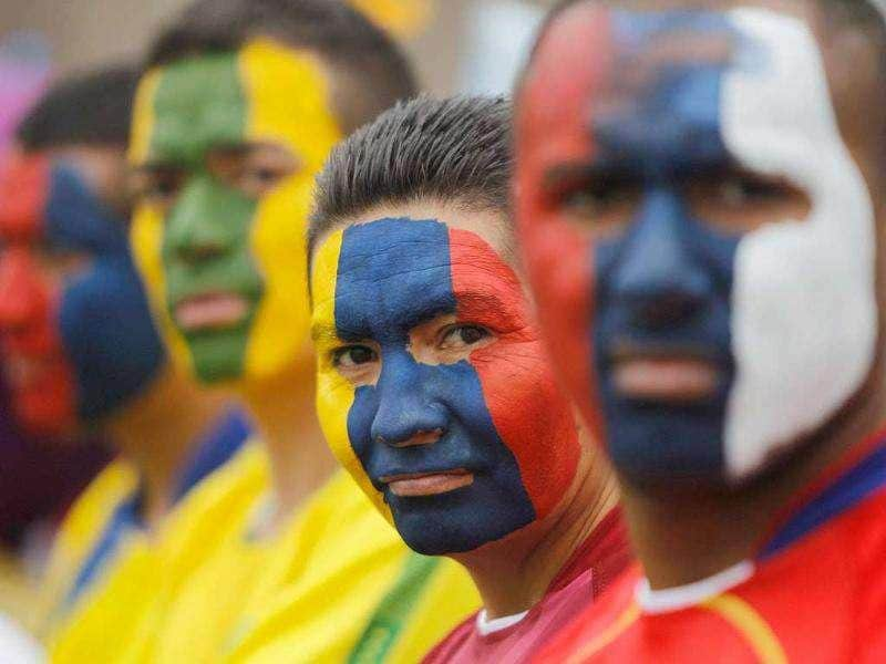 Peruvian prisoners with their faces painted with South American flags attend the final match of their mock Copa America soccer tournament at Castro-Castro prison in Lima.