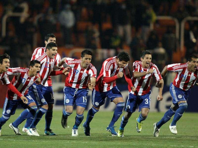 Paraguay's players celebrate after their teammate Dario Veron scored during the penalty shootout of the Copa America semifinal soccer match against Venezuela in Mendoza, Argentina. After the match ended 0-0 in extra time, Paraguay won 5-3 on penalties.