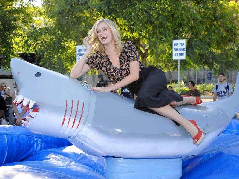 Actress Sara Paxton poses on a shark during an event for the movie Shark Night 3D held at the Comic-Con 2011 convention in San Diego.
