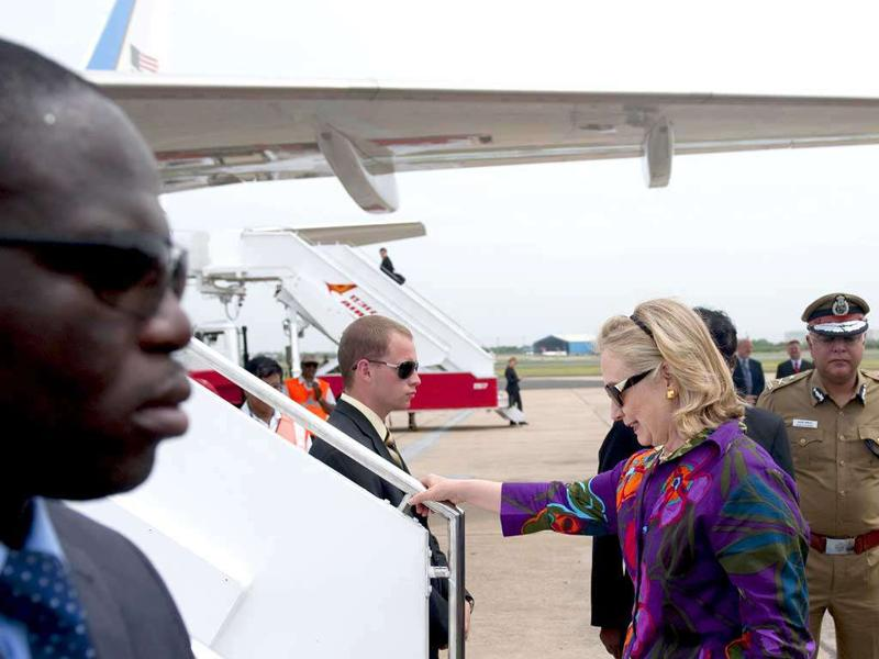 US Secretary of State Hillary Rodham Clinton steps onto her plane prior to departing Chennai.