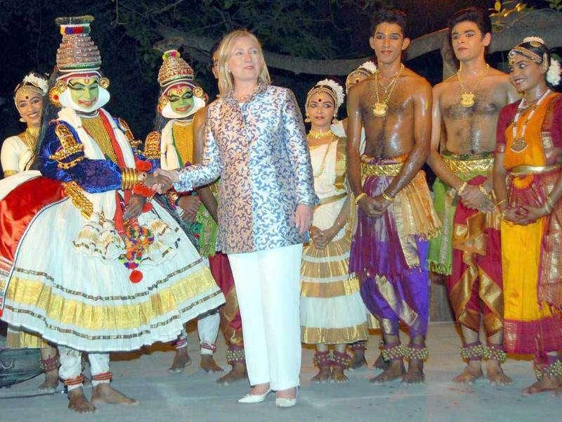 US Secretary of State Hillary Clinton shakes hands with an artist after enjoying cultural dance programme at Kalakshetra in Chennai.