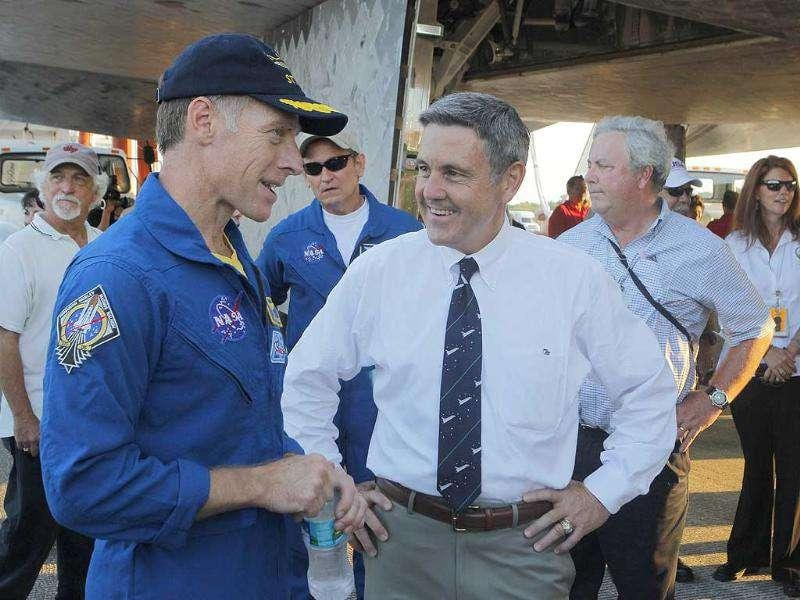 Space shuttle Atlantis mission commander Chris Ferguson speaks with Kennedy Space Center director Bob Cabana after landing at the Kennedy Space Center in Cape Canaveral, Florida.
