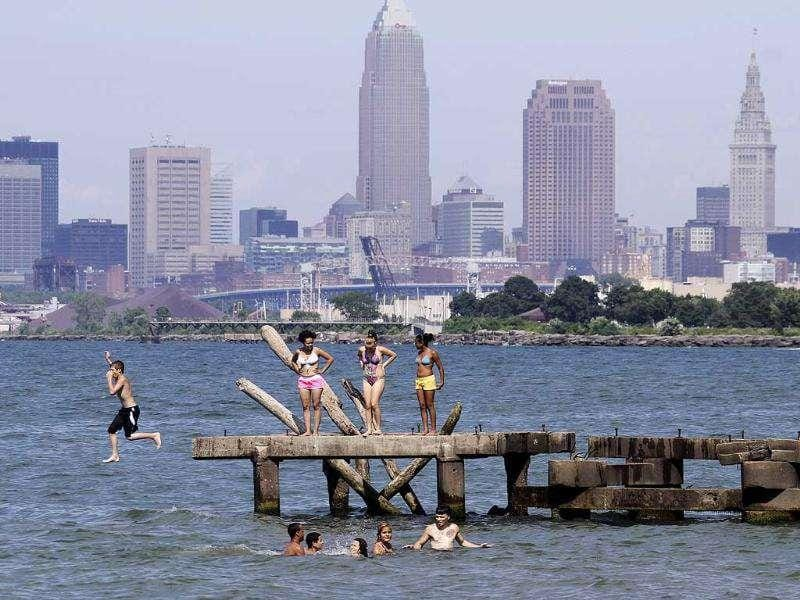 Swimmers cool off in Lake Erie at Perkins Beach in Cleveland.