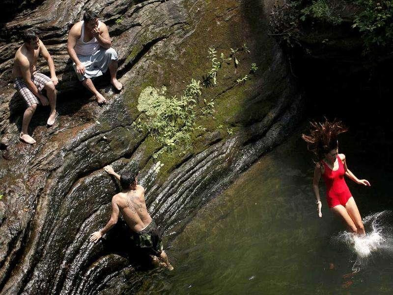 Bathers beat the midday heat at the Devil's Pool in Wissahickon Valley Park in Philadelphia.