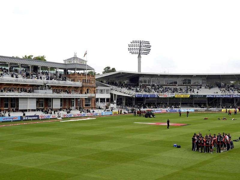 England (bottom right) hold a team talk before the Day 1 of the first Test match against India at Lord's Cricket Ground, London.