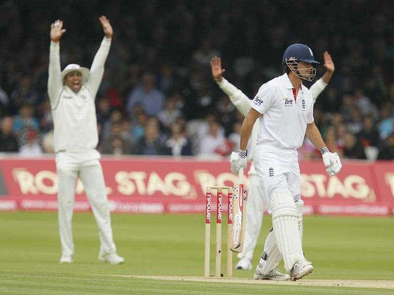 England's Alastair Cook survives an early lbw appeal by India's bowler Praveen Kumar (unseen) during the Day 1 of the first Test at Lord's Cricket ground in London.
