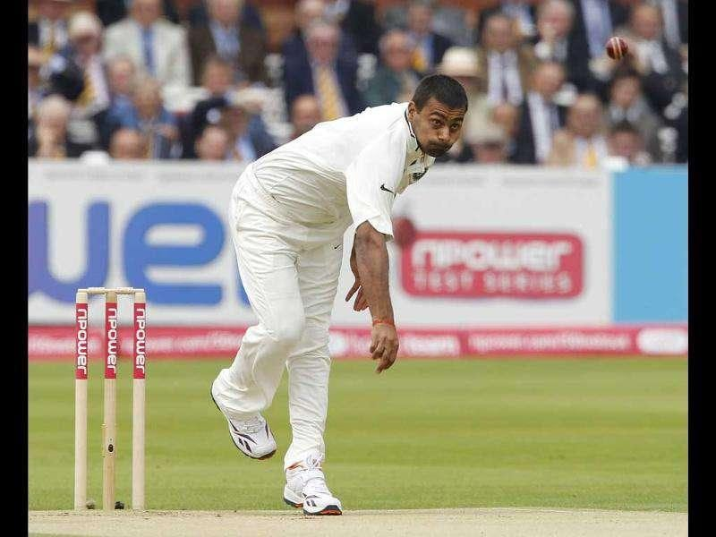 Praveen Kumar bowls during Day 1 of the first Test match against England at Lord's Cricket Ground in London.
