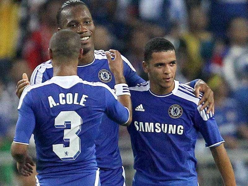 Chelsea's Didier Drogba (Rear-L) celebrates with teammates after scoring a goal against Malaysia, during a friendly match at the Bukit Jalil Stadium in Kuala Lumpur, part of the Chelsea Asia Tour 2011.