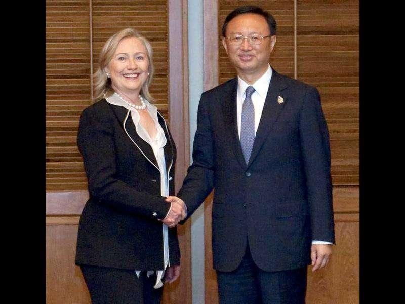 US Secretary of State Hillary Clinton (L) shakes hands with Chinese Foreign Minister Yang Jiechi prior to a meeting on the sidelines of the Association of Southeast Asian Nations (ASEAN) Ministerial Meeting in Nusa Dua.