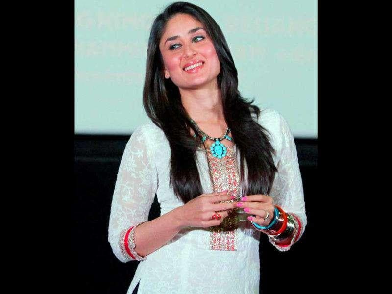 A healthy Kareena Kapoor looks gorgeous in a white kurta during the promotional event. (PTI)