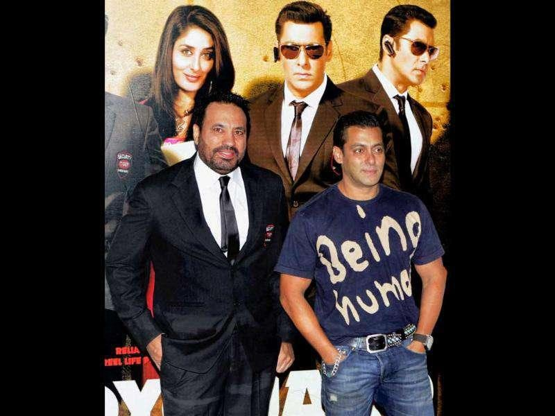 Actor Salman Khan is seen with his bodyguard Shera during the trailer launch of his forthcoming film Bodyguard. (PTI)