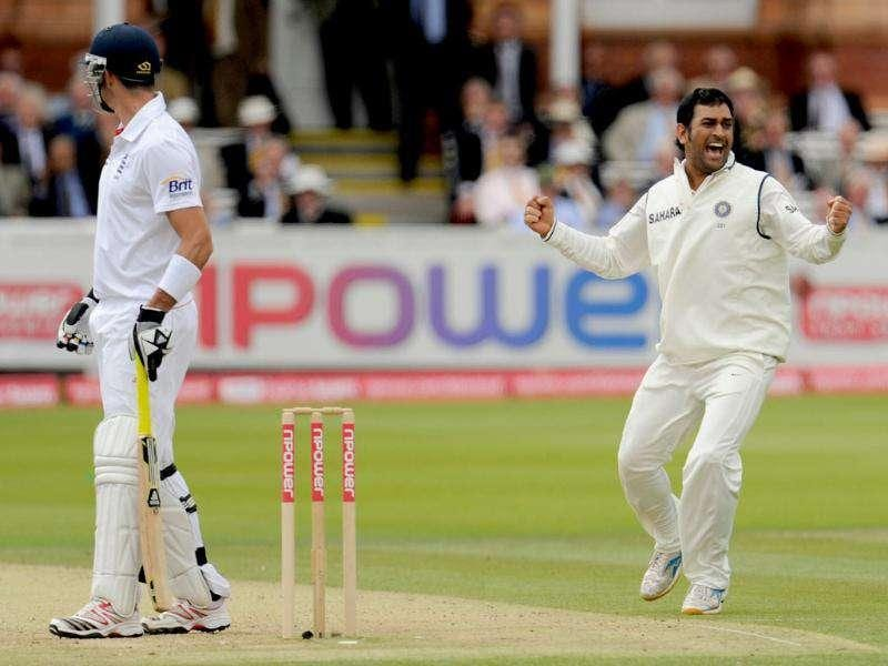 India's Mahendra Singh Dhoni celebrates after initially dismissing England's Kevin Pietersen's before the decision was reversed by the third umpire during the first cricket test match at Lord's cricket ground in London.