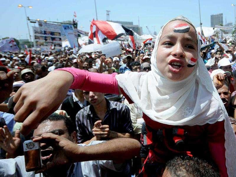 An Egyptian girl shouts slogans as pro-democracy protesters gather in Cairo's Tahrir Square to push for reforms.