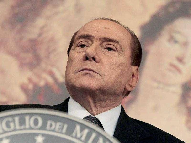 Italian Prime Minister Silvio Berlusconi attends a news conference at Chigi Palace in Rome.