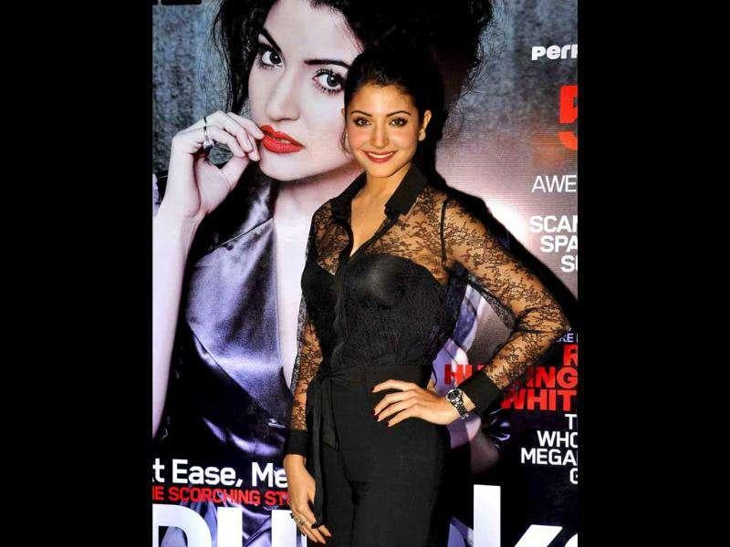 Looking gorgeous in a corset and pants, Anushka is all smiles during the the unveiling of 'Maxim' magazine covers.