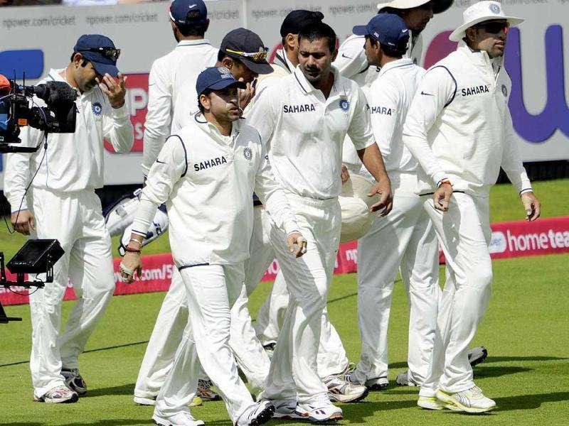 The Indian team take the field to play England during the 2nd day of the first Test match at Lord's cricket ground, London.