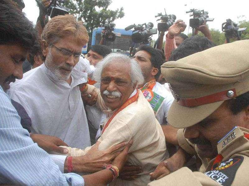 Police arrest former Union minister Bandaru Dattatriya along with other BJP workers during their demonstration demanding introduction of Telangana bill in Parliament, in Hyderabad.