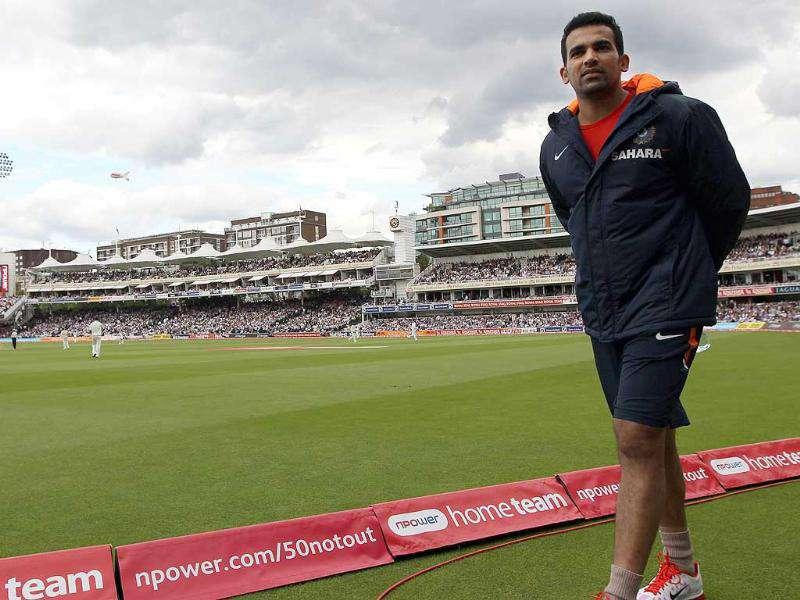 Injured Zaheer Khan walks around the boundary during the game against England during day two of the first Test match at Lord's in London.