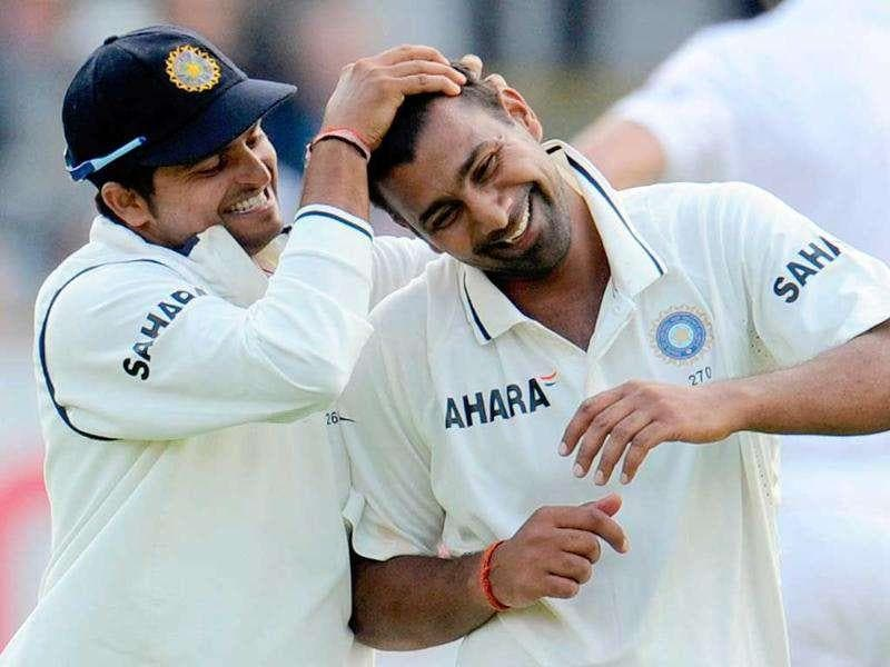 Praveen Kumar is congratulated by teammate Suresh Raina after dismissing Stuart Broad and claiming his fifth wicket of the innings during the first Test cricket match at Lord's cricket ground in London.
