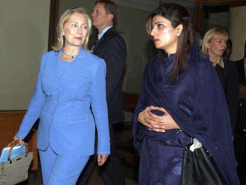 US secretary of state Hillary Rodham Clinton, left, walks with Pakistan's foreign minister Hina Rabbani Khar, at the 18th ASEAN Regional Forum in Nusa Dua, Bali, Indonesia.