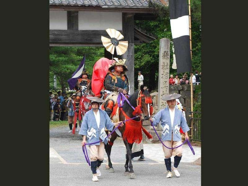 Residents wearing Samurai warrior armour parade on horses after the kick-off ceremony of the three-day Soma Nomaoi festival in Soma city, Fukushima prefecture. The festival, started more than 1,060 years ago, was forced to cancel two of its three key events as some of the venues are located in the 20 to 30 kilometre zone from the troubled nuclear plant, Fukushima Daiichi.