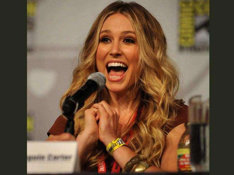 Sarah Sanguin Carter, an actress in the TNT drama series, Falling Skies, talks during a screening and panel discussion on the second day of Comic-Con 2011 in San Diego, California.