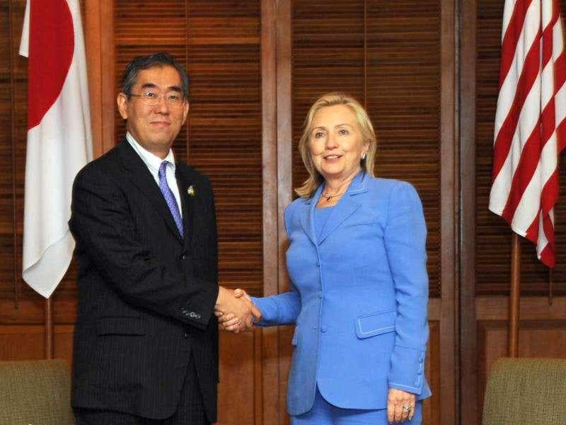 US secretary of state Hillary Clinton (R) shakes hands with Japanese foreign minister Takeaki Matsumoto before their bilateral meeting on the sidelines of the Association of Southeast Asian Nations regional forum in Nusa Dua on Indonesia's resort island of Bali.