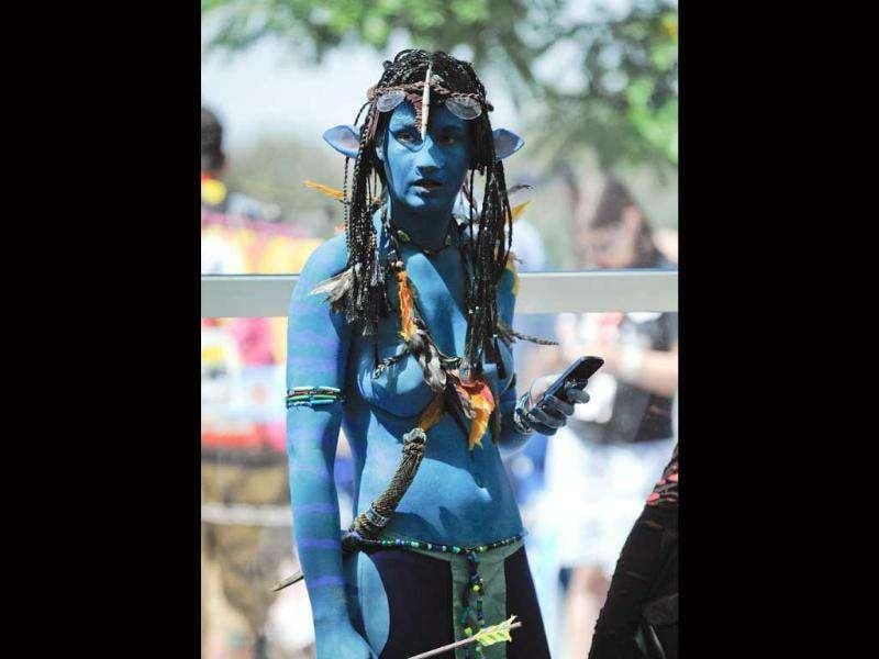 A fan dressed as a character from the movie Avatar stands in line during the Comic-Con International 2011 convention held in San Diego.