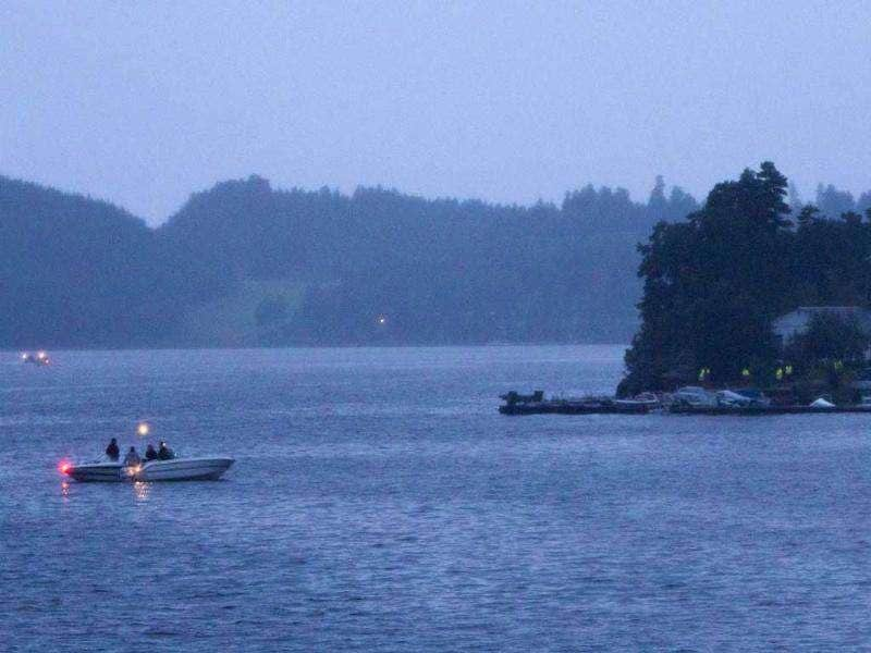 Police in boats and emergency service vehicles are seen at the Tyrifjord as a gunman went on the rampage some 40km south west of the capital Oslo.