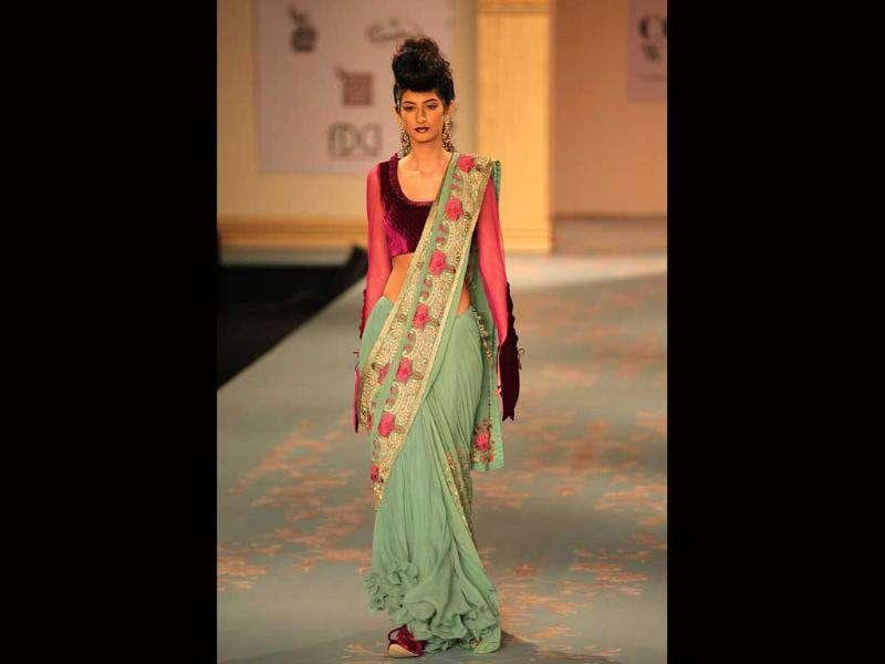 Saris were complemented with deep cut corset blouses, power shoulders and net sleeves.