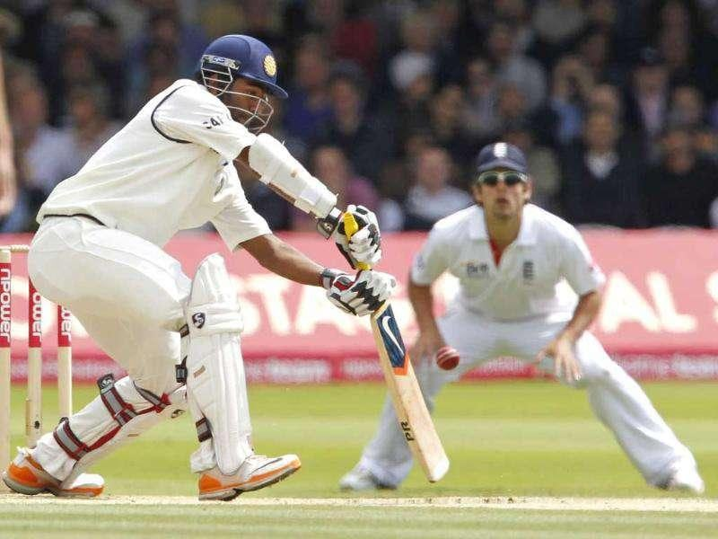India's Abhinav Mukund (L) hits a shot for 4 runs watched by England's Alastair Cook during Day 3 of the first test match at Lord's Cricket Ground in London.