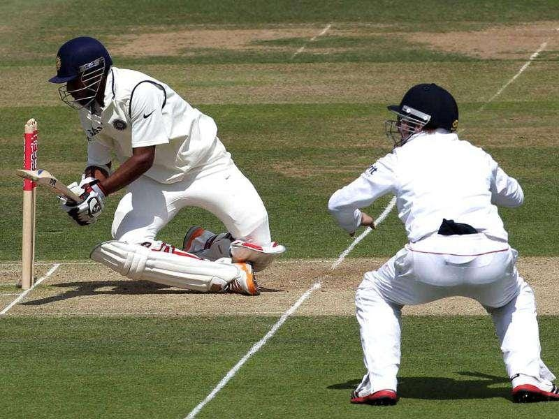 Abhinav Mukund loses his balance after playing a shot against England during Day three of the 1st Test match at Lord's Cricket Ground in London.