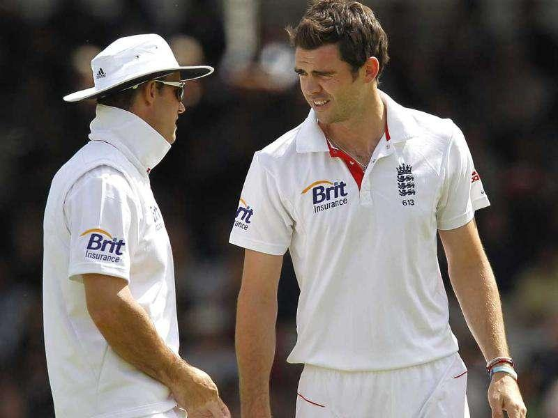 England's captain Andrew Strauss (L) talks to bowler James Anderson during Day 3 of the first Test match against India at Lord's Cricket Ground in London.