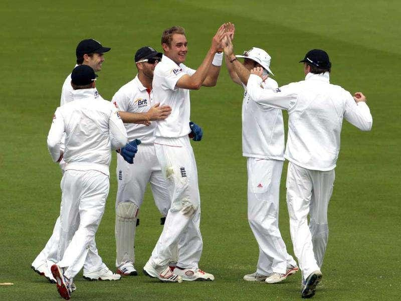 England's Stuart Broad (C) celebrates taking the first Indian wicket of Gautum Gambhir for 15 runs during Day three of the first Test match at Lord's Cricket Ground in London.
