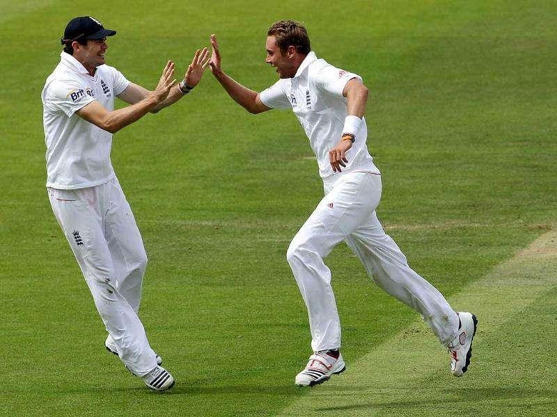 England's bowler Stuart Broad (C) runs to celebrate with James Anderson after taking the wicket of Sachin Tendulkar (R) during Day three of the 1st Test match at Lord's Cricket Ground in London.