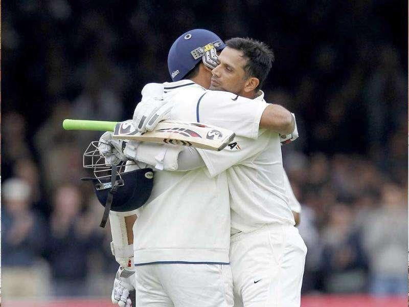 Rahul Dravid (R) is congratulated by Zaheer Khan (L) after he reaches 100 runs not out against England during Day 3 of the first Test match at Lord's Cricket Ground in London.
